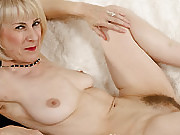 Busty blonde Susan Eubanks getting her ass poked by two lucky dicks