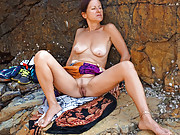Horny mature posing naked on a cliff