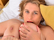 Pretty milf with big juggs ride a dong on the couch