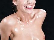 Alexis has a head covered in cum at her first big bukkake blowbang
