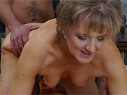 Amateur mature blonde fucks with the guy on a bed