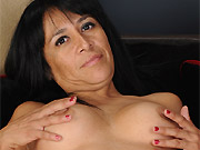 Busty dark-haired milf Isabella Montoya shows shaved pussy