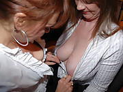 Lesbian co-workers kissing and fondeling