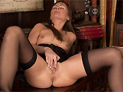 Karon Ross in black lingerie and stockings shows the pussy