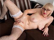 Sexy milf blonde Nika poses in black fishnet stockings