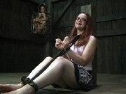 Hazel Hypnotic redhead is dungeon bound in metal made to orgasm