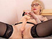 Busty milf blonde in black stockings plays huge dildo