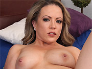 Busty milf blonde Carmen Valentina plays pussy on a bed