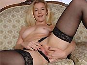 Sexy milf blonde Shakira May in black stockings strips