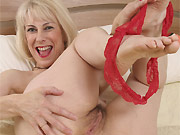 Mature blonde Hazel May strips and toying hairy pussy
