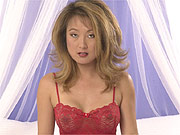 Classic Asian star strips lingerie on the bed