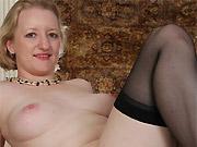 Anya Volkov busty milf blonde in black stockings strips