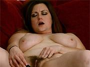 Annatasia Holland busty mom toying hairy pussy on sofa