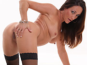 Michelle Lay poses in red lingerie and black stockings