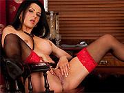 Dark-haired milf nurse Sienna Richardson poses in stockings