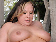 Busty mom Mary Jane strips and poses outdoors