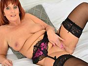 Redhead mom Beau Diamonds poses in black stockings