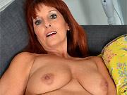 Horny redhead mom Beau Diamonds stripping on a sofa