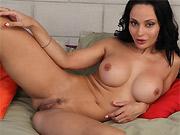 Dark-haired milf Crystal Rush shows big round boobs