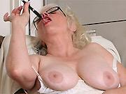 Busty mature secretary Zoe Zane in stockings strips at office