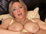 Bigboobs blonde Dee Williams in lingerie spreads on a sofa