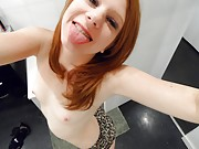 Perky little redhead with nice tits