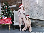 Two naughty sluts take a cock each on Christmas eve