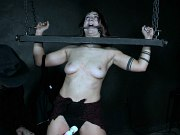 Jacey Jinx is spread bound and double toyed in dark bdsm dungeon