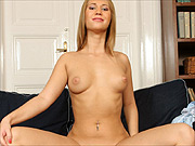Linda shows her shaved pussy on the sofa