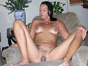 Mature Brunette MILF With A hairy Pussy Modeling And Spreading Nude