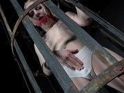 Alice in Dallas blonde in schoolgirl uniform is put in metal cage