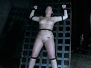 Maddy OReilly busty stripped bound in metal with pussy exposed