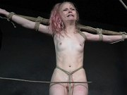 Alice in Dallas petite sub is bound in rope and stone in dungeon