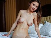 Arousing chesty slim brunette girl