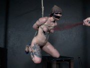 Ava DAmore petite redhead is rope bound for clamping and spanking