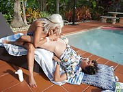 Granny with huge fake boobs fucks a young stud by the outdoor pool