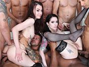 Two kinky sluts get all their pleasure holes gangbanged