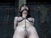 Kendra James busty babe rope bound and toyed in kinky dungeon