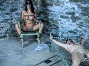 Lavender Rayne and Brina James bound in kinky dungeon are toyed