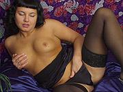 Amateur fingering in stockings herself