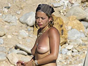 Rita Ora topless on a beach with friends