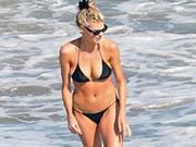 Charlotte McKinney out enjoying the sun at the beach in Malibu