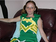 Freckled Face Amateur Redhead Girl Modeling Nude in Cheerleader Uniform