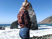 Busty Russian teen sucks dick by the ocean