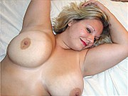 Amateur BBW blonde housewife is undressing and posing nude