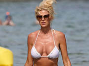 Victoria Silvstedt sexy in white bikini at Jardin Tropezina in Saint-Tropez