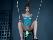 Scarlett Mae in blue dress and heels rope bound with red ballgag